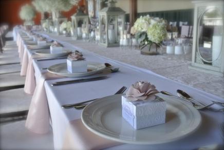 handmade paper roses adorn each favor box
